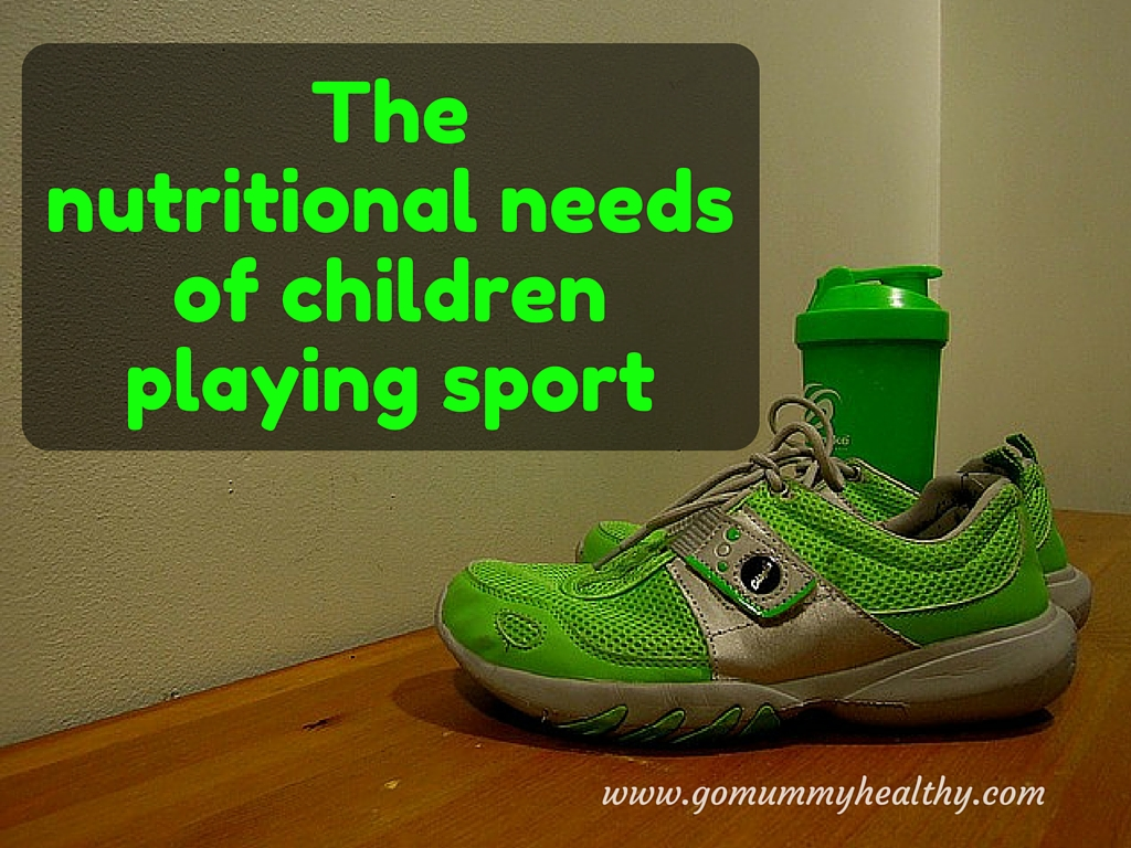 Sport nutrition for children - a pair of green trainers with green a cup in the background